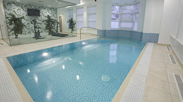 Our pool designer recommended a separated gym to ensure the pool room temperatures did not make the daily work out too unpleasant.
