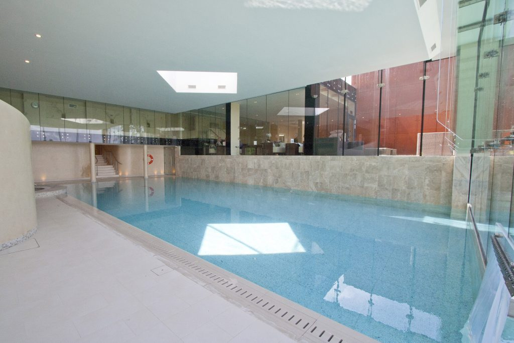 A rare design with deck level internal pool linked to a free board external pool