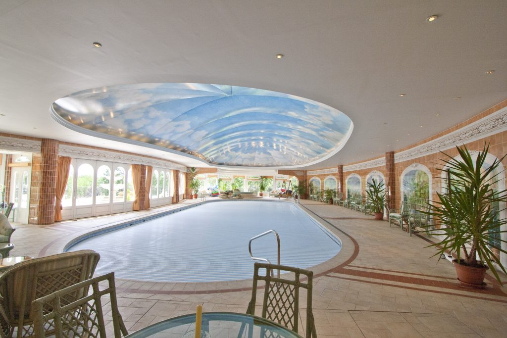 Troubleshooting of this large pool in Barnet focussed on the high running costs of a huge air cooling scheme not linked to a huge pool water heating scheme