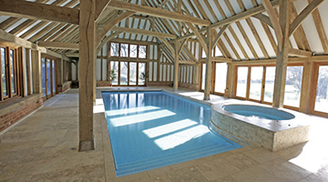 Another where our pool designer has integrated the spa into the pool but with a great deal of attention to the environment to assist protecting the natural oak frame